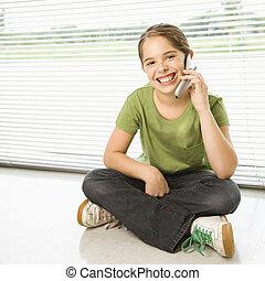 Preteen girl. - Caucasian preteen girl sitting on floor...