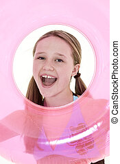 Preteen girl - Preteen caucasian girl acting silly on a...