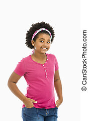 Preteen girl. - African American girl with hands in pockets...