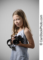 Preteen girl with a big camera