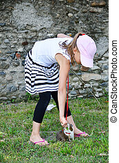 Preteen girl with a cavia