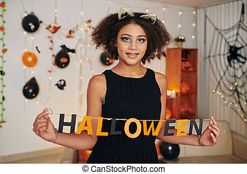 Preteen girl with Halloween letters
