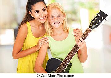 preteen girl with her music teacher - happy preteen girl...
