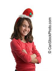 Preteen girl with santa claus cap
