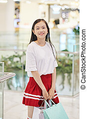 Preteen girl with shopping bags
