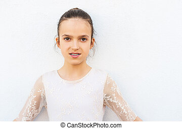 Preteen girl with teeth braces wearing beautiful dress