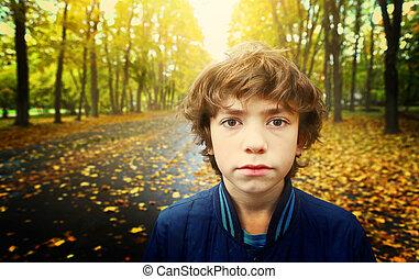 boy close up outdoor sad unhappy portrait