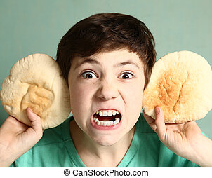preteen handsome boy perform beast image with tortilla ears sharp teeth close up portriat