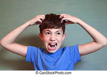boy scratch his head isolated on blue - preteen handsome boy...
