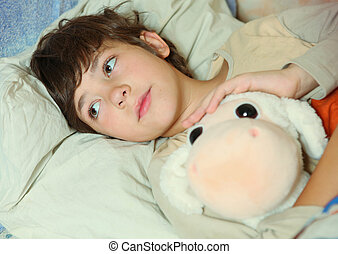 preteen handsome boy sick in bed with toy - preteen handsome...