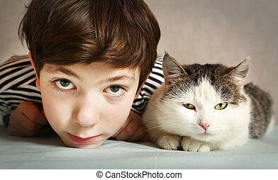 boy with siberian tom cat close up portrait