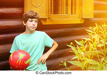 boy with soccer ball close up photo