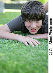 Preteen playing on the grass