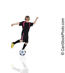 Preteen playing soccer