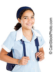 preteen schoolgirl wearing uniform and carrying schoolbag...