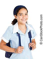 preteen schoolgirl wearing uniform and carrying schoolbag...
