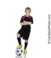 Preteen with a uniform for play soccer stepping the ball