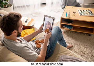 Pretending to eat cookie through tablet screen