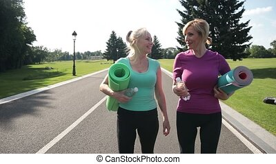 Pretty adult women going to training in the park - Beautiful...