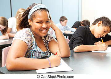 Pretty African-American Teen in Class - Pretty African-...