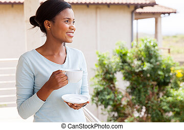 african american woman drinking coffee