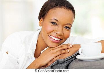 african american woman having coffee