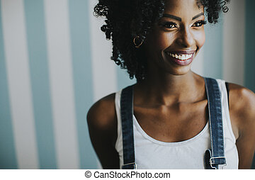 Pretty african american woman posing in jeans trousers
