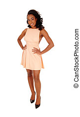 Pretty African American woman standing.