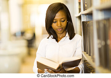 african college girl reading a book