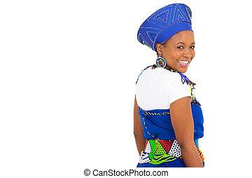 african girl looking back over her shoulder