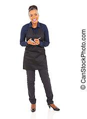 african waitress taking order