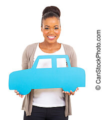 african woman holding a car symbol