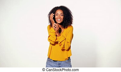Pretty african woman in yellow wear learned pleasant news...