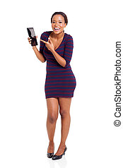 pretty african woman pointing at tablet computer
