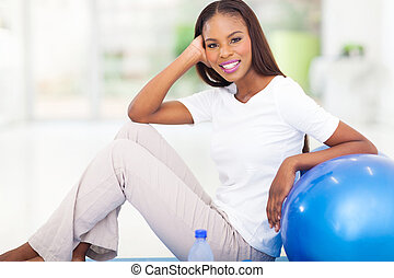 african woman resting after the exercise