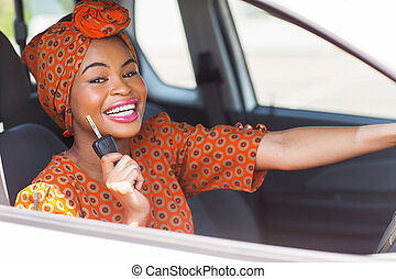 african woman showing car key - pretty african woman showing...