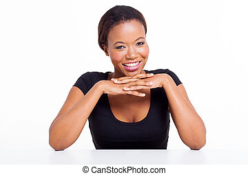 african woman sitting at a desk