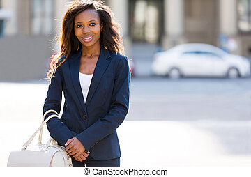 african woman standing in the urban street