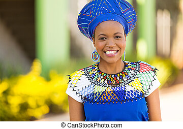 african woman standing outdoors