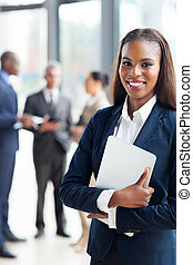 afro american businesswoman holding laptop