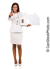 afro american woman holding paper house