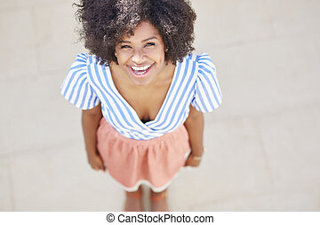 Pretty afro american woman laughing