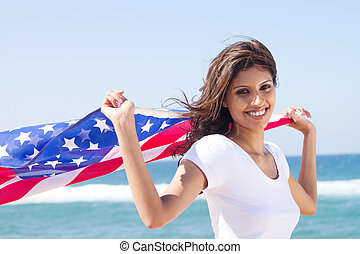 pretty american woman with flag