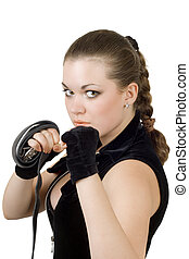 Pretty angry young woman throwing a punch. Isolated