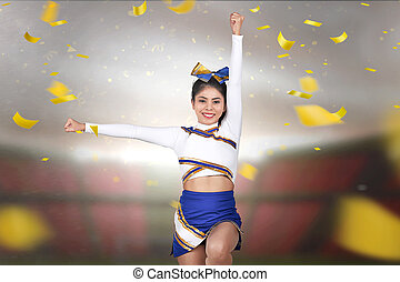 Pretty asian cheerleader perform with falling confetti background