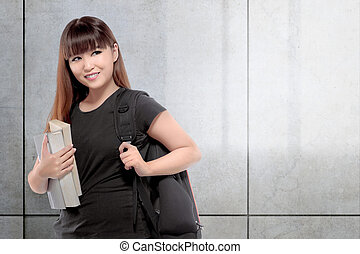 Pretty asian college student woman with book