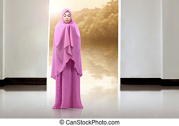Pretty asian musim woman praying to god