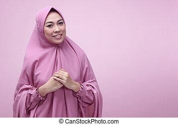 Pretty asian muslim woman wearing hijab dress