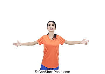 Pretty asian soccer player woman with winner gesture posing
