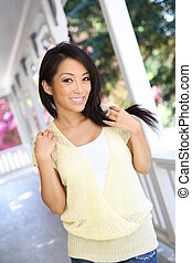 Pretty Asian Woman at Home